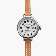 The Birdy 34mm grey leather watch with grey face showcases a classic dial, elevated design and enduring materials highlighted by a Swiss quality quartz Argonite 775 movement, which is hand assembled in Detroit from over 50 Swiss and other imported parts.