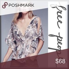"""NWT Free People Cold Shoulder Amour Top ➖NWT  ➖BRAND: Free People  ➖SIZE: Small     ➖LENGTH: 28.5""""  ➖STYLE: A cold Shoulder Top with slit bell sleeves , a crossover front with pleated details ➖MATERIAL: 95% Rayon 5% Spandex  ❌ NO TRADE Free People Tops Blouses"""