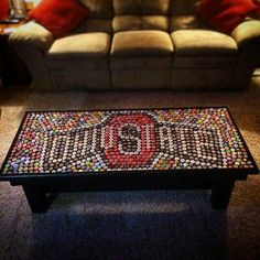 ohio state table made from bottlecaps. PS I love your hat! Beer Cap Table, Bottle Cap Table, Beer Bottle Caps, Bottle Cap Art, Bottle Top, Ohio State Rooms, Ohio State Crafts, Iowa State, Bottle Cap Projects