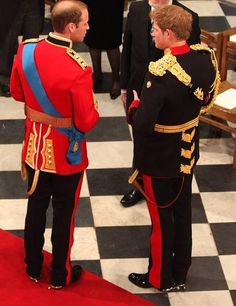 Prince William, the groom chats with the best man at his wedding, Harry on the day of his wedding to Kate Middleton - royal wedding day photos