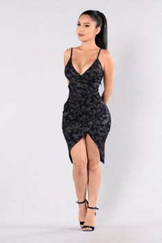 - Available in Navy - Knee Length Dress - Overlap Ruched Bottom - Spaghetti Straps - V Neckline - Silver Sparkle Design - 97% Polyester 3% Spandex