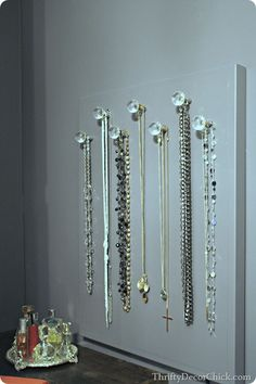 A #DIY necklace holder with decorative knobs