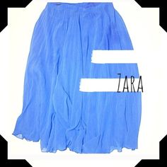 "Zara Skirt z a r a    s k i r t s i z e : s l e n g t h : 3 0 . 3 "" w a i s t : 2 7 "" p o l y e s t e r g r e a t   c o n d i t i o n , n o    l o n g e r  h a s   p l e a t s                                                         [more] : flowy, blue, maxi skirt, casual, summer    Smoke Free Pet Free Price Negotiable through 'Offer Button' 20% off Bundles Zara Skirts"