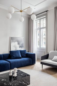 Studio Autori take art deco to a new level by restoring a classic Serbian apartment in the heart of Belgrade's Obilićev Venac pedestrian area. Condo Living, Living Spaces, Living Rooms, Small Living, Blue Couches, Minimalist Apartment, Piece A Vivre, Scandinavian Interior, Frames On Wall
