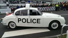 A Mark 2 Jaguar police car which formed part of a parade of Jaguar and Land Rover heritage vehicles at the Lode Lane plant to mark the start of Jaguar production there