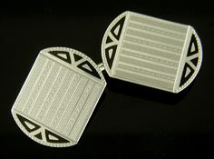 Elegant black enamel accents and white gold centers engraved with alternating straight and zig-zag pinstripes. These black and white cufflinks relect the cool sophistication of the Art Deco era. Crafted in 14kt gold, circa 1930. http://www.jewelryexpert.com/catalog/TH-Art-Deco-Black-and-White-Cufflinks-J9251.htm