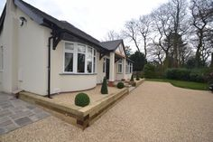 Stabilised Gravel driveway with sleeper raised beds in Sale, Cheshire