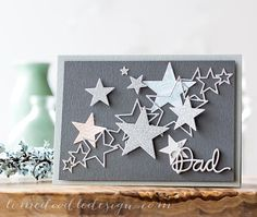 handmade Father's Day card: limedoodlestardad ... shades of gray .... die cut stars in various sizes ... some solid ... some outline... luv how they are arranged in a spray diagonally across the card ... great card!