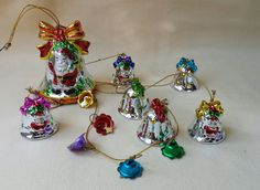 Vintage Christmas Santa Bells wind chime. 1970s. Ornaments, festive, holiday decor. In excellent condition. Porcelain, shiny glaze. NO chips, cracks, crazing or repairs. Large bell measures approx. 3 by 2-1/2. 6 small bells measure approx. 1-1/2 by 1-1/4.  **EXTRA 20% OFF with Coupon Code PLVIP20 @ Checkout (if you spend $25 or more) ONLY ONE COUPON PER ORDER ** A note: Shipping seems excessive sometimes. I use USPS Priority, 2-3 day delivery, on all glass items. The less time ...