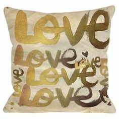 """Pillow with a gold-hued text motif.   Product: PillowConstruction Material: Woven polyesterColor: GoldFeatures:  Insert includedSealed closure Dimensions: 18"""" x 18""""Cleaning and Care: Spot treat with damp cloth"""