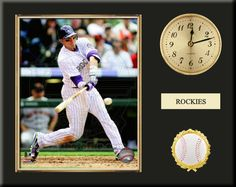 One 8 x 10 inch Colorado Rockies photo of Carlos Gonzalez inserted in a gold slide-in frame and mounted on a 12 x 15 inch solid black finish plaque.  Also features a 3-inch Arabian gold-faced clock, a customizable nameplate* and a 2-inch baseball medallion with a gold base.  $59.99 @ ArtandMore.com