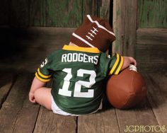 Green bay packer baby photo..lets just add pony tails to this beannie