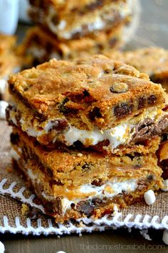 These S'mores Cookie Bars are gooey wonders! This easy, foolproof recipe produces supremely thick and chewy cookie bars bursting with chocolate and marshmallow!
