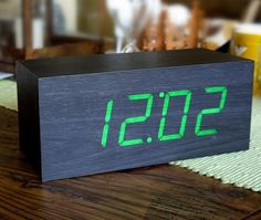 Wood Alarm Clock by Gingko  An innovative and eco-friendly wooden alarm clock that can light up your Time, Date and Temperature...  $125 USD