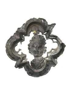 Pilgrim badge from the shrine of St Thomas Becket at Canterbury Cathedral. This badge is in the form of a mitred head within a barbed quatrefoil frame. Late Medieval; 14th century ID no: 8801