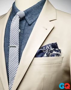 The GQ Guide to Pocket Squares. I like the tan and chambray blue combination.