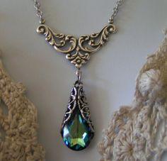 Iris Goddess Of The Rainbow   IRIS - Greek Goddess of the Rainbow - Bermuda Blue Swarovski Crystal ...