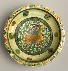 "Incised Aghkand Dish - ADC.76 Origin: Central Asia Circa: 12 th Century AD to 13 th Century AD Dimensions: 3.98"" (10.1cm) high x 11.22"" (..."