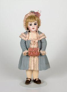 77.6369: doll