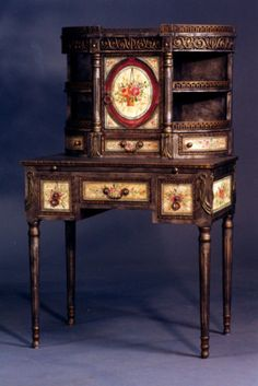 Victorian Desk - Inspired by an aristocratic English antique auctioned at Christies, this lovely ladies' desk offers a pull-out surface for writing, lined drawers, antiquated crackle finish, and a myriad of details.