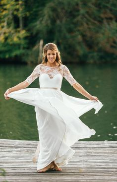 Satin belt, traditional wedding gown, lacy 3/4-length sleeves, sandals // Erin Morrison Photography