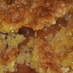Caramel Apple Dump cake recipe - •2 cans of apple pie filling (you can also use cherry, blueberry, etc.) •1 box of yellow cake mix •2 sticks of butter, melted (1 cup) •1/2 cup caramel sauce (like you would put on ice cream) •1/2 tsp cinnamon (optional) •1/2 cup chopped pecans (optional) •Whipped cream for garnish (optional)