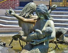 The mermaid fountain in Ghirardelli Square, San Francisco Bay. She is breastfeeding her mermaid-baby!