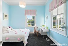 This girls bedroom is painted in the crisp blue Resene Onahau trimmed in Resene Alabaster.