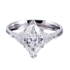 1.52 Ct E/IF Marquise with Trillions in Platinum | From a unique collection of vintage engagement rings at http://www.1stdibs.com/jewelry/rings/engagement-rings/