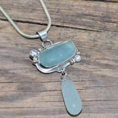 Sea glass pendant two pieces of aqua sea glass in a sterling silver setting accented with sparkly CZs.
