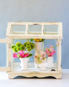 How-To: Arrange Mini Bouquets in Our Wooden Terrarium Kiana, owner of Tulipina, a boutique San Francisco-area floral design studio (see more of her work here and here) recently experimented with adding some out-of-the-box floral arrangements to the Pottery Barn Wooden Terrarium