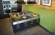 Mirror splashback wooden bar stools and wooden bar on for Ak kitchen cabinets calgary