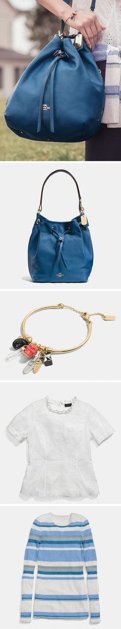 A summer must-have: the Coach Turnlock Tie Bucket Bag in denim blue with light gold hardware. Complete your look with our favorite pieces.