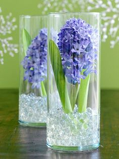 Time permitting grow tulips, paperwhites, daffodils, or your favorite bulb flower.  Either cut or dig up bulb, clean off dirt and place in tall vase available at dollar store with addition of glass rocks for centerpiece.  Could get flowers from other source too.