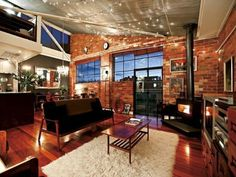 Home Design Concept with Natural Landscape: Sensational Living Room Interior Design With Wooden Flooring Style Wooden Table Dark Sofa And Br. Luxury Interior Design, Interior Design Living Room, Room Interior, Magazine Design, Dark Sofa, Warehouse Apartment, Loft Studio, Industrial House, Industrial Chic