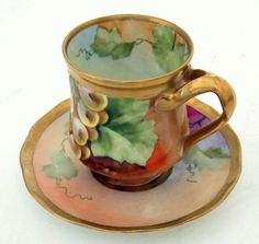 similar to mine, ANTIQUE GINORI DEMITASSE CUP & SAUCER HAND PAINTED GRAPES LEAVES 1900 - 1930, sold 80$