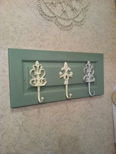 Towel hooks on old cabinet door