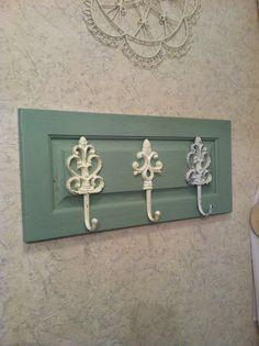 Towel hooks on old cabinet door