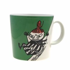 Green Moomin Mug - Little My Sledding This item is no longer available. The iittala Arabia green Little My Sledding Moomin mug has a Little My sliding down a hill on one side and on the other side we get a rear view of her wading . Moomin Mugs, Tom Of Finland, Little My, Sled, Tableware, Green, Lead Sled, Dinnerware, Tablewares