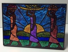 """This is a stained glass image, hand painted on the reverse side of the glass of a 5x7 picture frame, then accented with aluminum foil behind the glass. The """"Going to Market at Sunrise"""" featuring three"""