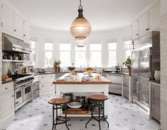 I'm feeling quite yucky today, so I thought I'd post some pretty, bright pics. These are all of kitchens and dining areas I thought were especially cheerful.