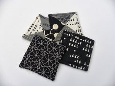 Monochrome Patchwork Coasters - lovely combination of fabrics. This page links to another page which links through to a tutorial.