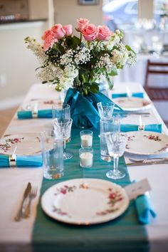 A table from an intimate backyard ceremony with in-home reception.    Love the roses, the runners, the vintage plates!  You can just feel the family love in this wedding setting.