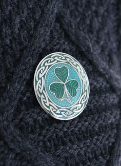 Celtic Shamrock Enamel Brooch: This brooch is inspired by Ireland's rich cultural heritage. Rendered in emerald hues, it features the shamrock surrounded by a celtic knotwork design.triskele or triple spiral. The Shamrock is without doubt the most recognised symbol of Ireland and is said to bring good luck and fortune to all those who wear it. A wonderful Irish Gift idea. #shamrock #brooch #jewelry #jewellery #green #enamel #pin #scarfring #irish #celtic