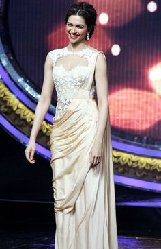 Deepika Padukone in a stunning champagne sari with a white lace corset blouse
