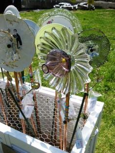 Beautifully embellished salvaged glass plate garden stakes were available for the picking.