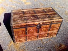 Large wooden trunk, Wooden with a paper covering inside and out. metal trim around the edges, This is a sturdy chest bottom which is bad on a lot of chest is good. This has not been restored it is as I found it, Hardware is all good. Great for a coffee table. I do have a smaller one that matches this . It will fit inside this large one. Size 32x17x17, Does have wooden handles on the sides.