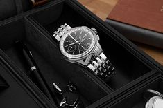 Looking at the Breitling Premier Chronograph 42 (Ref.A13315351B1A1), one thing quickly becomes clear: the old brand image seems to have changed. We love the new look! Breitling Watches, Chronograph, Old Things, Steel, Luxury, Image, Accessories, Black, Black People