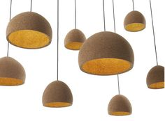 Todo para después | Float, Pendant Light by Benjamin Hubert.  The blocks are made from recovered waste that is the result of wine cork manufacturer.