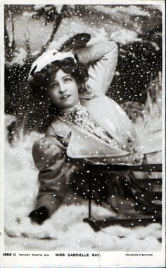 Gabrielle  Ray, falling off sled in the snow, ca. 1900
